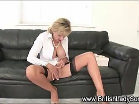 Lady Sonia masturbates on her leather couch